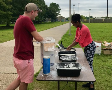 Jonathan and Nacaya making the corn starch run for the Girl Scouts