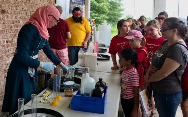 Rana Ghannam making elephant toothpaste for the Girl Scouts